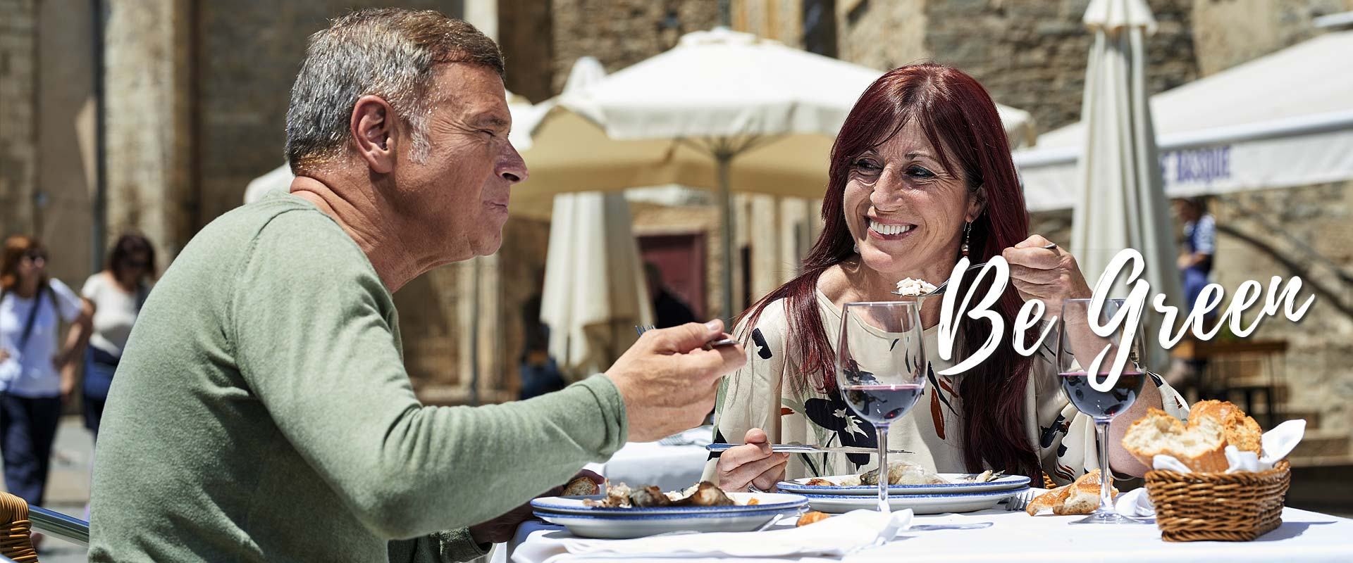Two people eating on a terrace