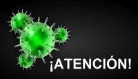 Se ve un dibujo de un virus con la palabra atención